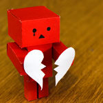paper robot with a broken paper heart